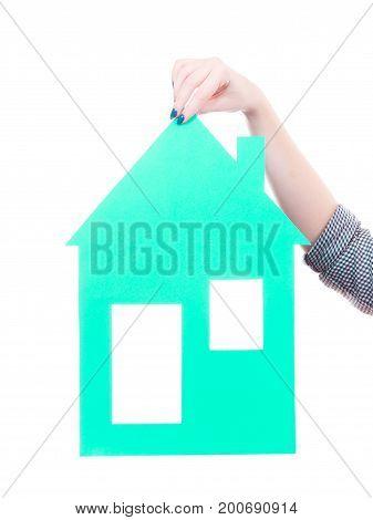 Female Hand Holding Green House Model.