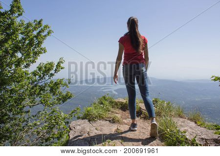 Eco tourism and healthy lifestyle concept. Young hiker girl with backpack. Active hikers. Tours on the viewing platform In the mountains reserve