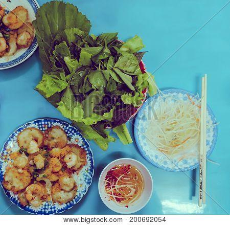 Closeup of Making Vietnamese Savory Mini Pancakes or Banh Khot