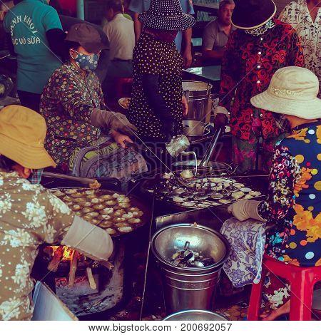 VUNG TAU / VIETNAM, 20 AUGUST 2017 - Chefs are making Vietnamese mini savory pancakes or Banh Khot in a very famous restaurant called Banh Khot Goc Vu Sua in Vung Tau, Vietnam