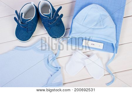 Test With Positive Result Of Pregnant And Clothing For Newborn And Kids, Expecting For Baby