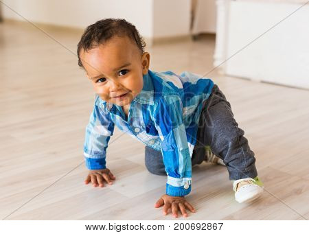 Happy Mixed Race Toddler Baby Boy indoors