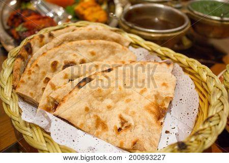 Indian naan bread in basket selective focus