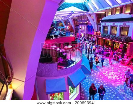 Barcelona, Spain - September 06, 2015: Royal Caribbean, Allure of the Seas sailing from Barselona on September 6 2015. The second largest passenger ship constructed behind sister ship Oasis of the Seas. Passengers walking inside the ship