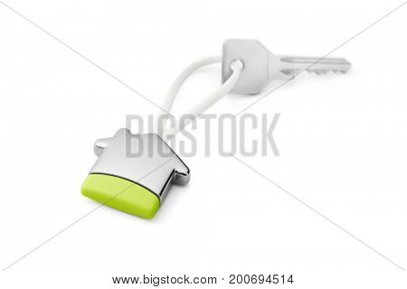 Concept green house -House key on a house shaped keychain, included clipping path