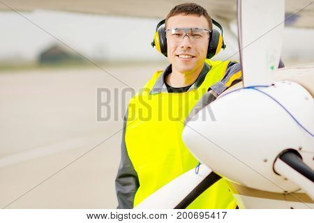 Male airport worker runway control happy maintenance