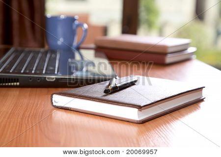 Organizers Pen  Laptop On Desk