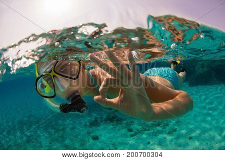 Snorkeling woman exploring beautiful ocean sealife, underwater photography. Travel lifestyle, water sport outdoor activities, swimming and snorkeling on summer beach holidays.