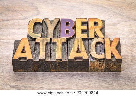 cyberattack  word abstract in vintage letterpress woodtype printing blocks