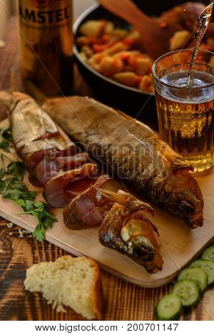 You have fish, smoked Omul from lake Baikal for dinner whith beer and fried potaoes. Very testy appetizer for beer. Organic food. Rustic style.