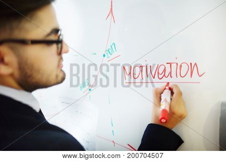Young teacher pointing targets and objectives for future business