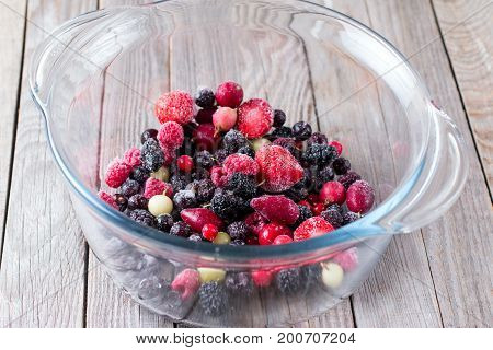 Frozen berries in a glass bowl, frozen food