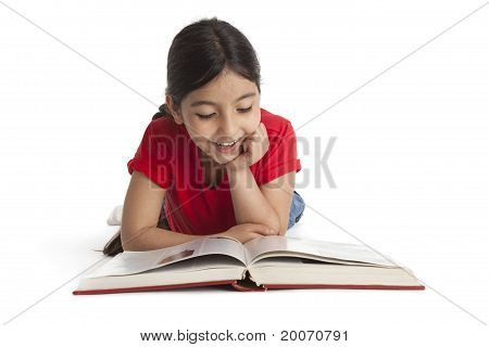 Eight year old girl reading a book