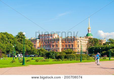 ST PETERSBURG RUSSIA - AUGUST 15 2017.The Field of Mars - large park in center of St Petersburg Russia and St Michael or Engineer castle in St Petersburg Russia