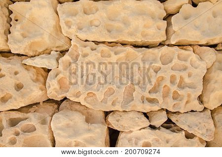 Wall of a large sandy yellow stone