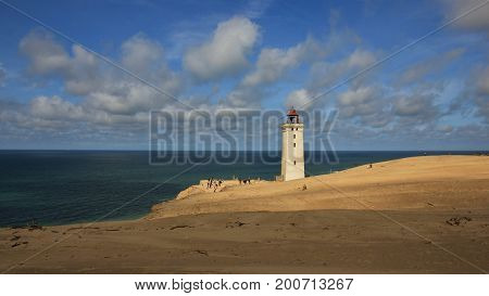 Big sand dune at the west coast of Denmark. Lighthouse on the Rubjerg Knude.