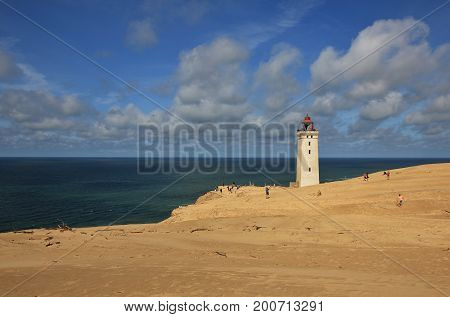 Old lighthouse on the Rubjerg Knude. High sand dune at the west coast of Denmark.