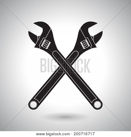 Adjustable wrench. Crossed black icons. Vector illustration
