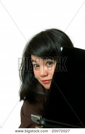 Asian Young Businesswoman Peered From Behind The Laptop