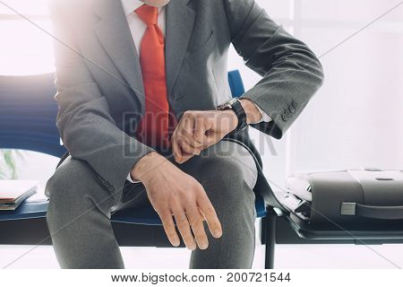 Corporate Businessman Waiting And Checking The Time