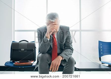 Depressed Businessman In The Waiting Room