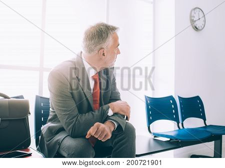 Impatient Businessman Waiting For A Meeting