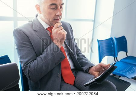 Businessman Connecting With His Tablet