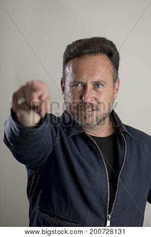 Upset Bearded Adult Male Pointing Finger