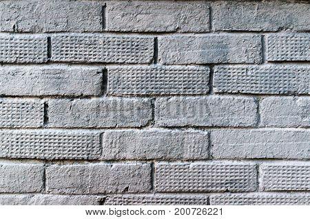 Gray painted old brick wall. Brick texture