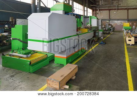 New surface grinding machine. Modern production of grinding machines.