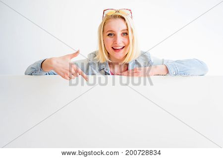 A portrait of a stylish girl pointing at something