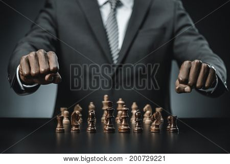 African American Businessman And Chess Figures
