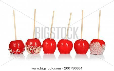Delicious candy apples on white background