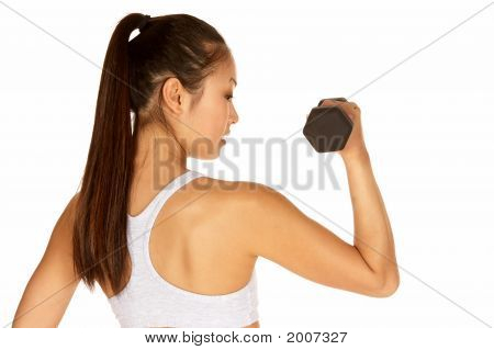 Young Asian In Sports Bra With Dumbbell