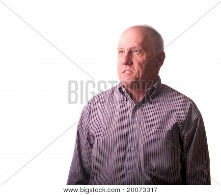 Older Bald Man In Striped Shirt Looking Up And Away
