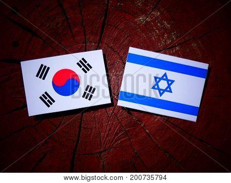 Israeli Flag With South Korean Flag On A Tree Stump Isolated