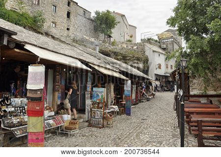 Bosnia and Herzegovina Mostar - June 1 2014: shopping arcades and cafes on the street in Mostar
