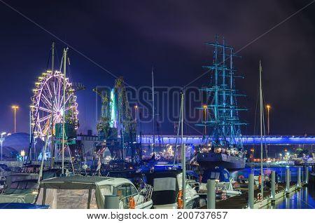 MARINA AT NIGHT - Yachts and sailing ship Mir moored at the wharf of the marina in Szczecin