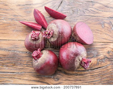 Red beet or beetroot on the wooden table.
