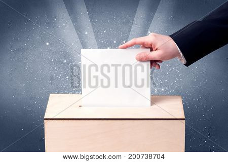 Ballot box with person casting vote on sparkling background