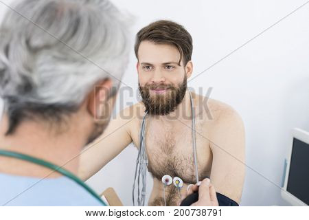 Patient Looking At Doctor While Undergoing Electrotherapy