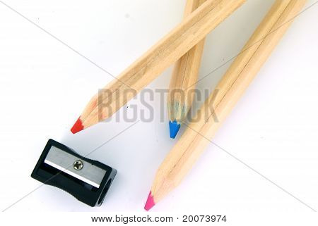 Pensils And A Sharpener On White Background