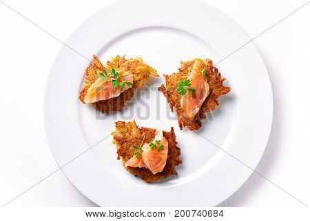 hash browns and salmon isolated on white background. top view