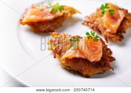 hash browns and salmon isolated on white background.