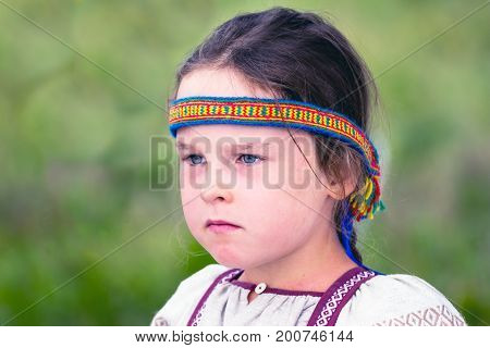 SAMARA REGION, RUSSIA - AUGUST 6, 2017: Portrait of a girl in traditional Slavic clothes