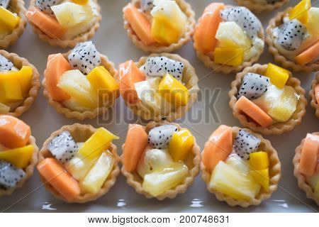 Mixed fruit tart. A custard base tart filling with various fruits on top