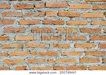 red brick wall merged by cement background and texture