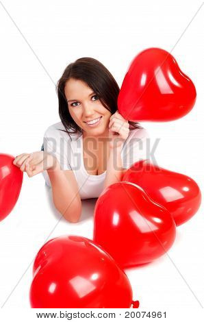 young brunette with red hearts isolated