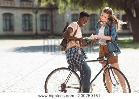 Multiethnic Couple Near College