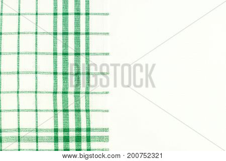 Green Cloth, A Kitchen Towel With A Checkered Pattern, On A Whit